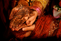 The hands of a bride and groom at a traditional wedding