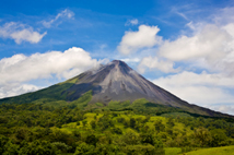 Volcano Arenal in Costa Rica on a partly cloudy day. Northeastern slopes.
