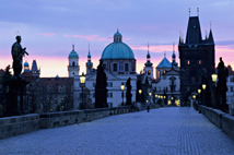 Prague skyline viewed from the Charles bridge at dawn (Czech Republic).